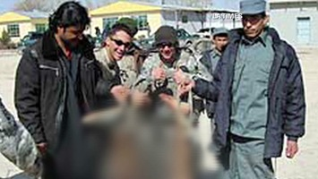 walsh-afghan-bodies-troops-pose-00002004-story-top