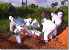 Uomini sotterrano un uomo morto di Ebola