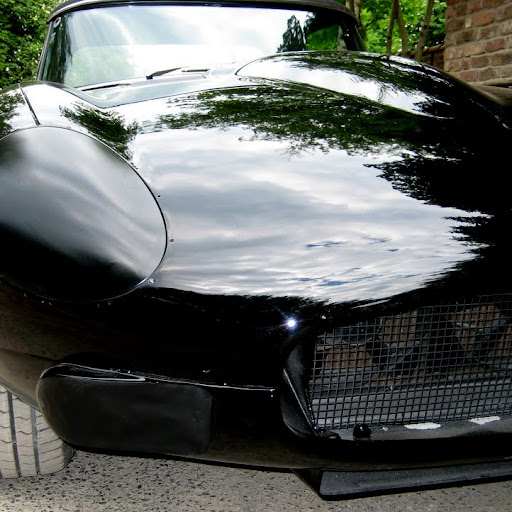 Prototype Jaguar XK-E, with Head-Light-Cover-Kit. The Head-Lamp-Cover Conversion-Kit made by designer Stefan Wahl in the tradition of Malcolm Sayer. / Jaguar e-Type mit Scheinwerferabdeckungen, designed und hergestellt von Designer Stefan Wahl in der Tradition von Malcolm Sayer.