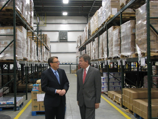 Brown gives Blunt a tour of the warehouse.