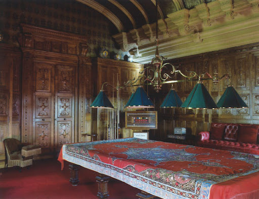 The decoration of this billiard room at Waddeson Manor is lavish; the vaulted ceiling is stamped with gilded leather between the ribs.