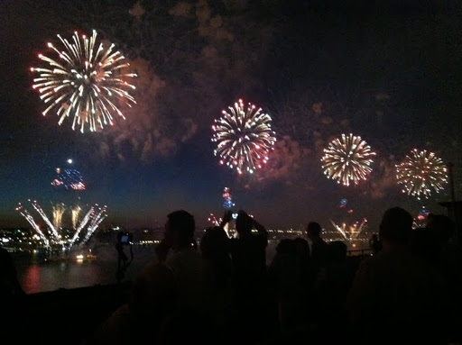 You can see fireworks exploding from four of the six barges.