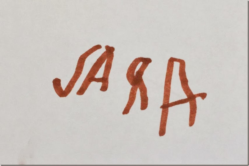 Sara writes her name-small