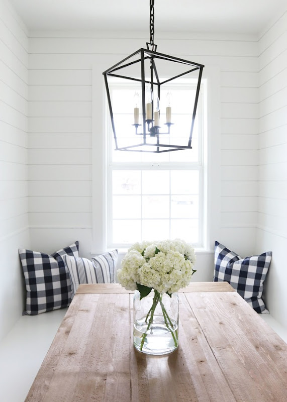Farmhouse table with lantern and shiplap walls -- Studio McGee
