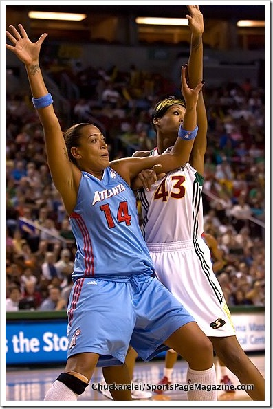 Erika DeSouza #14 calls for the ball while being denied by Ashley Robinson #43. (WNBA: Seattle Storm 63 v Atlanta Dream 92, Key Arena, Seattle, WA August 13, 2011)