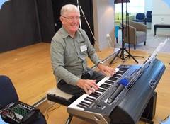 Gordon Sutherland playing his Korg Pa3X. Photo courtesy of Dennis Lyons.