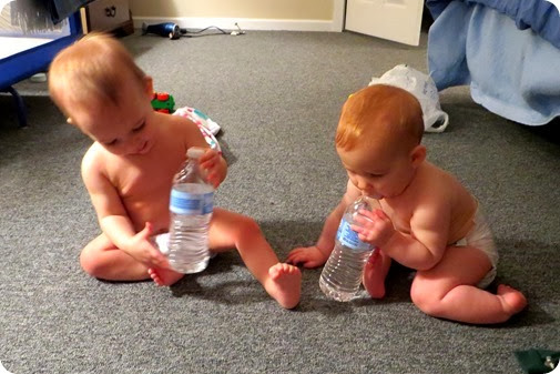 Twins with water bottles