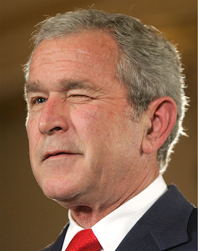 "US President George W. Bush winks while speaking on US policy regarding Cuba at the State Department in Washington, DC, 24 October 2007. Bush vowed to maintain the four-decade US economic embargo on Fidel Castro's Cuba as long as the government keeps its ""monopoly"" on political and economic power.             AFP PHOTO/Saul LOEB"