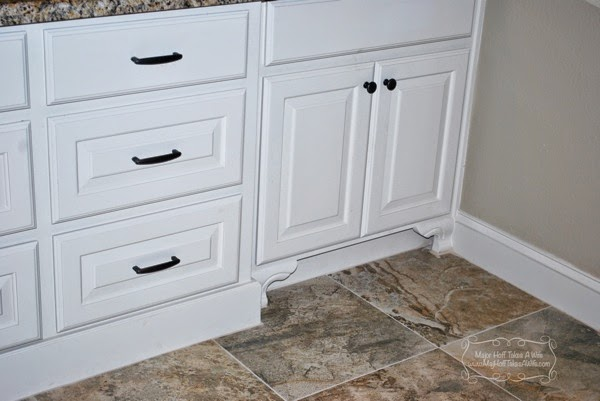 Curved feet detail of floor molding on bathroom cabinets