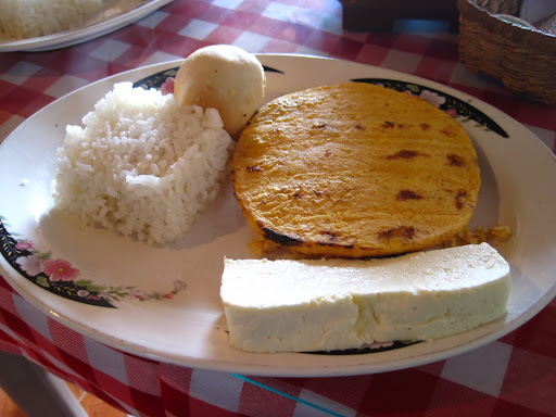 A hearty Colombian breakfast before our hike - rice, corn arepa, eggs, and cheese