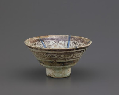Rakka ware bowl | Origin:  Raqqa,  Syria | Period: 12th-13th century | Details:  Not Available | Type: Stone-paste with cobalt under colorless transparent alkali-silicate glaze, luster over glaze | Size: H: 6.5  W: 12.3  cm | Museum Code: F1908.125 | Photograph and description taken from Freer and the Sackler (Smithsonian) Museums.