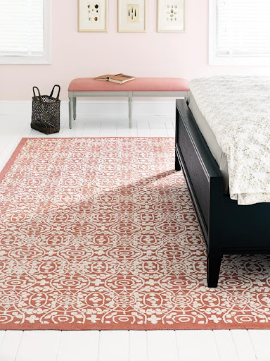 The pattern on this rug is so intricate. The darker shade brings an imperative contrast to the pastels of the room, proving area rugs can be as much a statement piece as a background color.