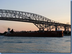 3727 Ontario Sarnia - Blue Water Bridge over St Clair River at sunset - Great Lakes Trader barge being pushed by the tug Joyce L. VanEnkevort