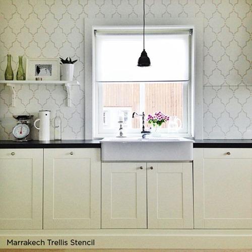 Unique stenciled wall in kitchen