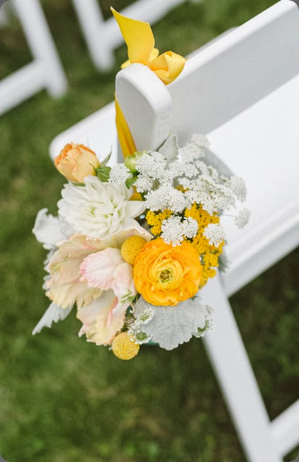 pew end western-wi-barn-weddings-wisconsin-wedding-florist-orange-and-yellow-bouquet Jeff loves Jessica Photography and studio fleurette