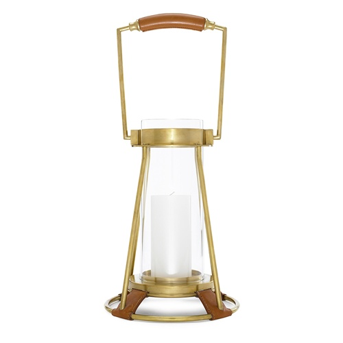 I've included several lanterns in this post, but this one in particular draws my attention. The combination of leather and brass is very attractive.  (chelseagiftsonline.com)