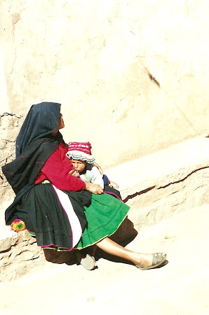 Woman feeding by breast in Peru