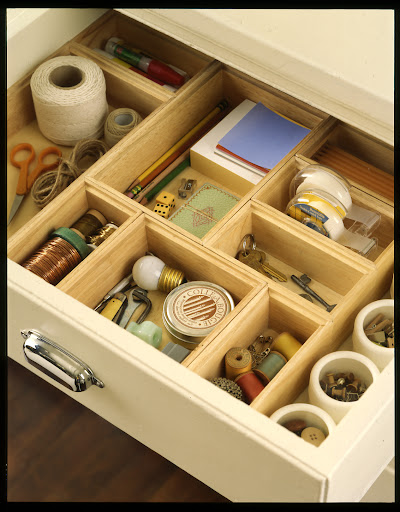 A junk drawer doesn't need to look junky.  Wood organizers separate items to help you find what you need.
