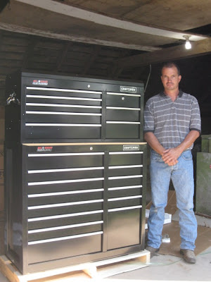 Curt Ikerd with his new tool chest.  Photo courtesy of the Iowa Soybean Association.