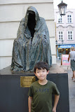 Kai at the Il Commendatore statue in Old Town