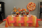 Bryan's own take on color for our set including a pretty ombré tablecloth and lots of bright flowers and candles.