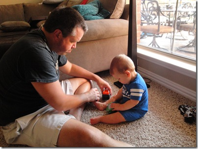 1.  Daddy teaching Knox how to play with his first cars