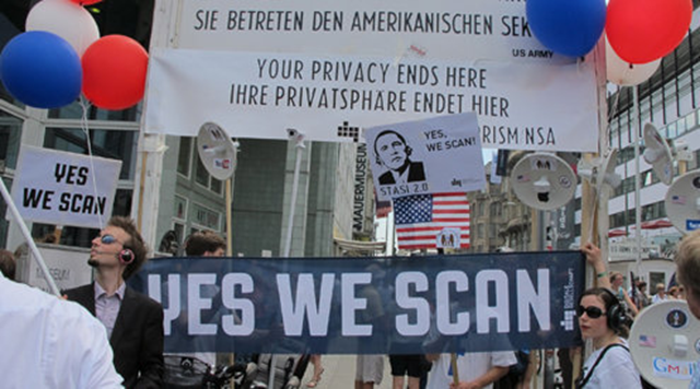 Protestors greeted President Obama when he visited in June 2013. They are upset over the NSA spying. Signn read 'Yes We Scan'. Photo: Claudia Himmelreich / McClatchy
