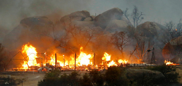 The Yarnell Hill fire, which on 1 July 2013 expanded tenfold, covering more than 8,000 acres. Photo: David Kadlubowski / The Arizona Republic / Associated Press