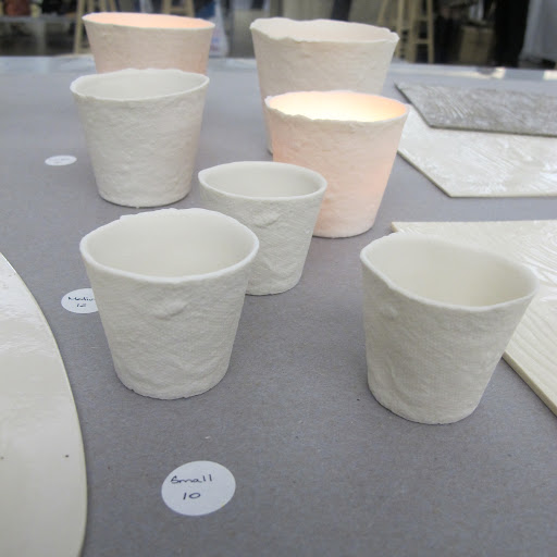 These ceramic votives are from crafter Marcie McGoldrick. http://marciemcgoldrick.com/