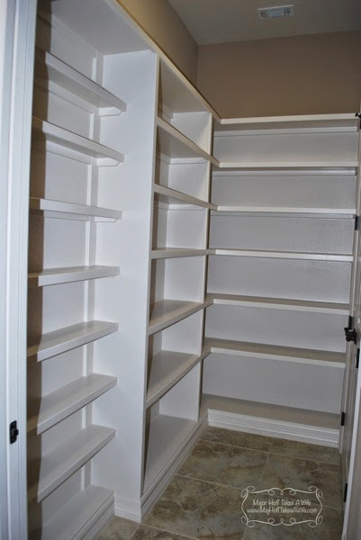 Large pantry with different depth shelves