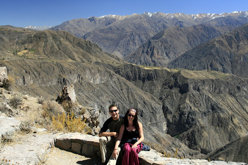 Beaming smiles, a hot shower is just around the corner, with the layered vista of Colca Canyon behind.