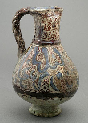 Ewer | Origin: Syria | Period: late 12th-early 13th century | Collection: The Madina Collection of Islamic Art, gift of Camilla Chandler Frost (M.2002.1.38) | Type: Ceramic; Vessel, Fritware, underglaze and overglaze luster-painted, Height: 9 3/4 in. (24.76 cm)