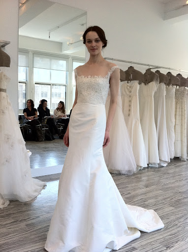 This gown can be worn with or without a peplum -- a great option if you want a quick change for your reception.