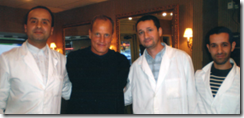 Actor Woody Harrelson with some of the barbers at the Terminal Barbershop in Toronto, Canada