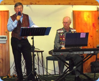 MC, Len Hancy, and Peter Brophy playing at the Raglan Club Saturday Night Concert. Peter is playing his Korg Pa3X