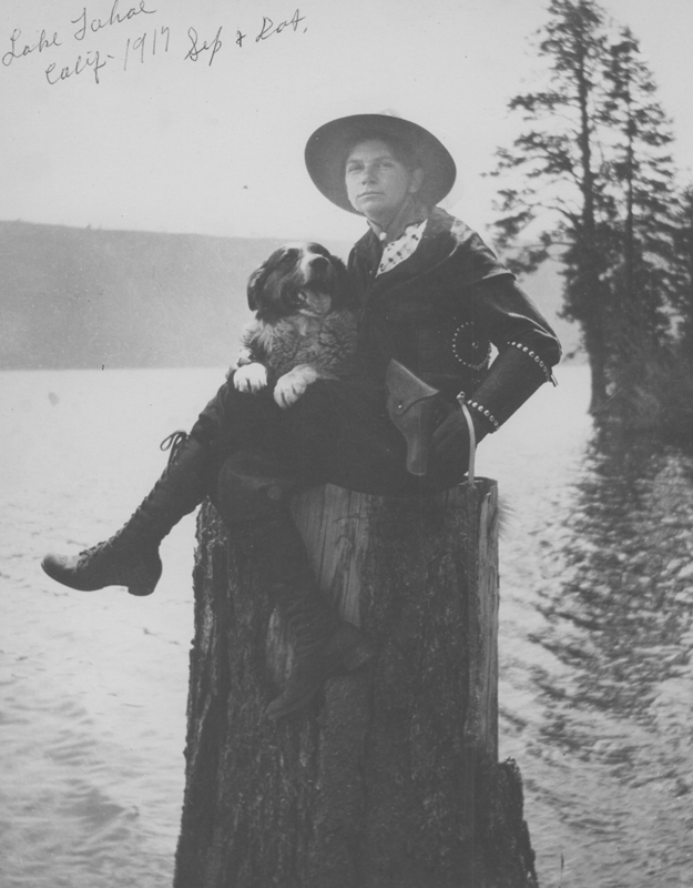 Dorothy Putnam with her dog Shep on a tree stump in Lake Tahoe, CA. 1917.