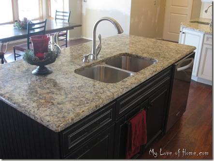 black island, white cabinets,  new venitian gold granite