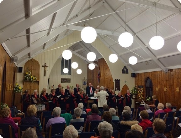 Musical Director Phil Houghton conducts the Wistaston  Singers