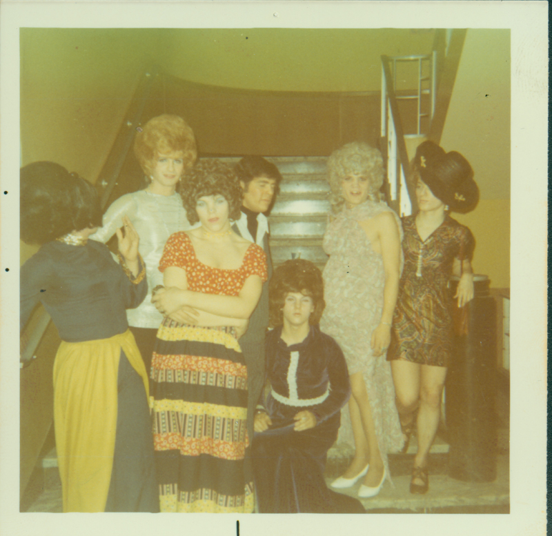 Drag queens gather for a night out. Circa 1971-1974
