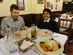 A photo of two people about to enjoy a meal delivered to their table