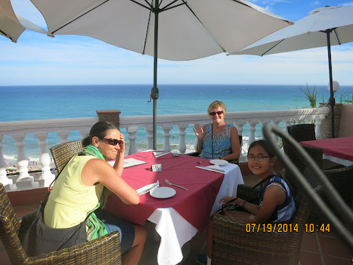 Dinner - we started out on this patio overlooking the beach, but the wind blew umbrellas, broke dishes, and we moved