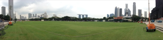 The cricket pitch in the centre of Singapore - and that boat thing in the distance...