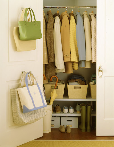 Adding shelving to the bottom of a entry closet keeps everything neat.