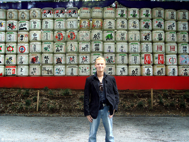 in front of a large amount of sake barrels in Yoyogi, Tokyo, Japan