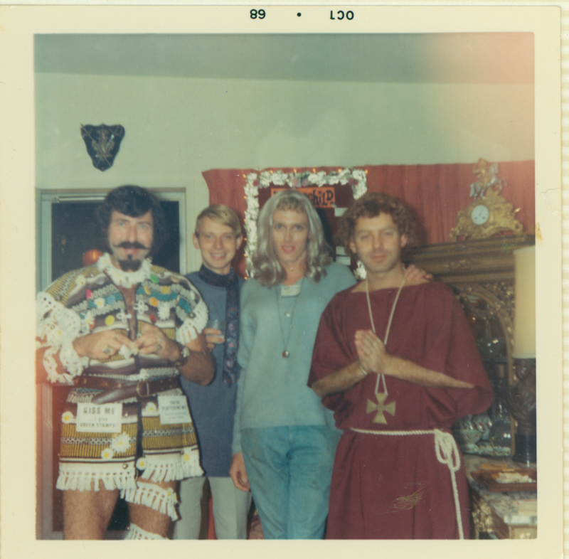 Matthew of Glendale with friends at a costume party presumably at his home. Buddy and Matthew of Glendale often held costume parties at their house as an alternative to the bar scene. October 1969.