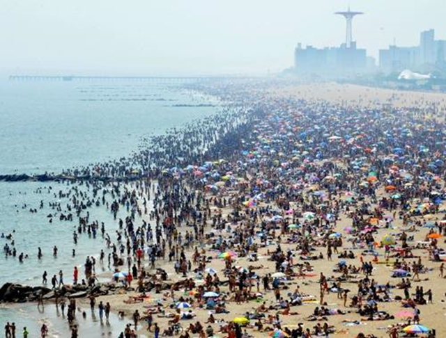Thousands flock to the beach in Coney Island during a heat wave, 11 June 2011. Photo: NY Post
