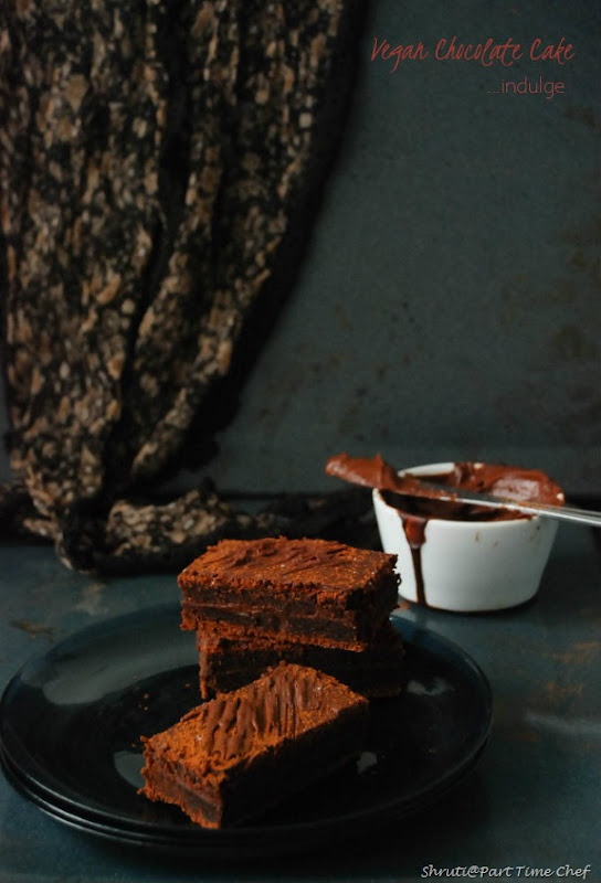 Vegan chocolate cake with vegan ganache frosting_stacked with cloth