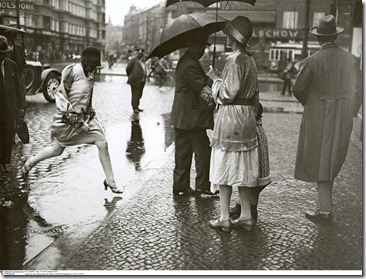 Jumping over a puddle near Berlin Zoological Garden station,1930 by Friedrich Seidenstücker