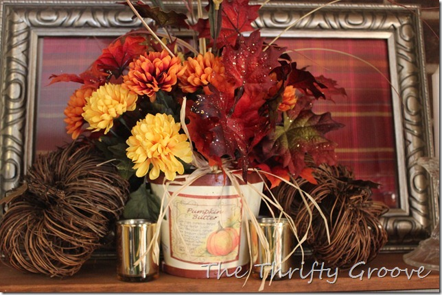 A thrift store frame used a different way in Fall decorating. Create a custom look for under a dollar. I used all thrift finds for this Autumn shelf. .