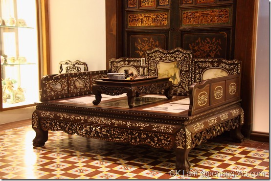 Boutique hotel, Seven Terraces on Stewart Lane, Penang by renowned hotelier Christopher Ong and Karl Steinberg houses many Baba Nyonya and Chinese antique furniture and collectibles - antique bed with mother-of-pearl inlay